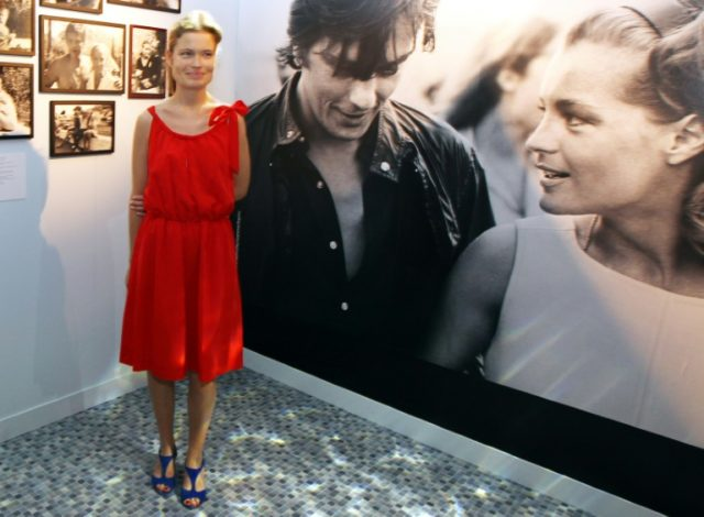 "Sarah Biasini, shown here beside a picture of her mother Romy Schneider with Alain Delon, said she wanted ""people to stop trying to make money on lies"" about one of Europe's biggest postwar female stars"