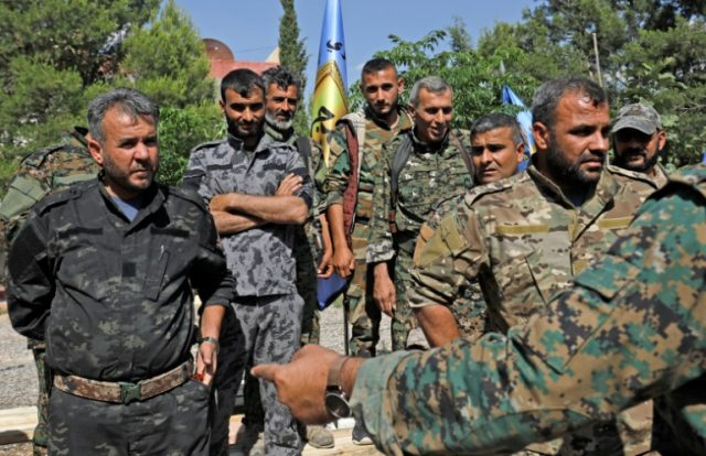 Members of the Manbij military council are pictured in the town on June 6, 2018