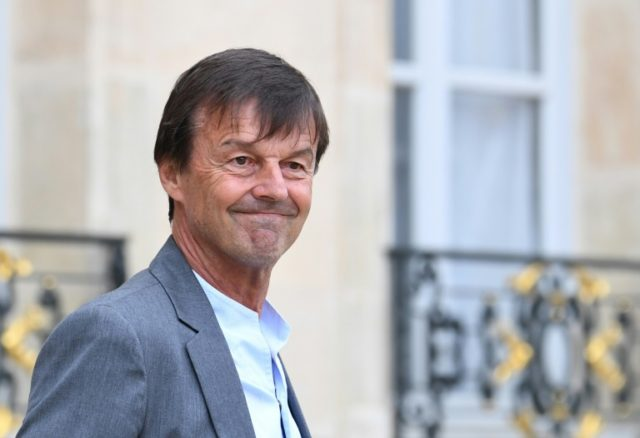French Ecology Minister Nicolas Hulot has said he will remain in President Emmanuel Macron's cabinet, despite a series of moves seen as setbacks to his environmental agenda