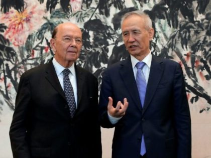 US Commerce Secretary Wilbur Ross (L) chats with Chinese Vice Premier Liu He after their meeting at the Diaoyutai State Guesthouse in Beijing, on June 3, 2018