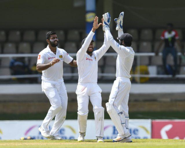 L-R: Lahiru Kumara, Kusal Mendis and Niroshan Dickwella of Sri Lanka celebrate the dismissal of Shai Hope of West Indies