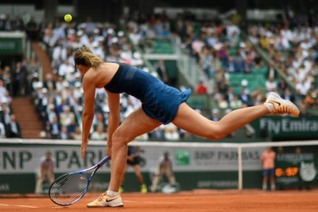 Low points: Maria Sharapova returns the ball to Garbine Muguruza