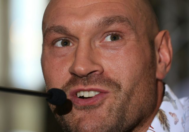 Former world heavyweight champion Tyson Fury speaks at a pre-fight conference in Manchester