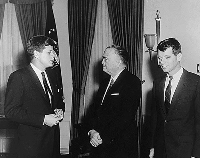 Robert F. Kennedy (R) in the Oval Office in February 1961 with his brother President John F. Kennedy and FBI Director J. Edgar Hoover