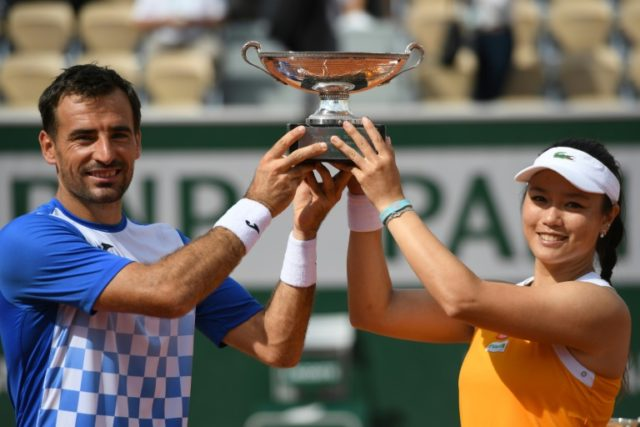 Champions: Taiwan's Latisha Chan and Croatia's Ivan Dodig pose with the mixed doubles trophy