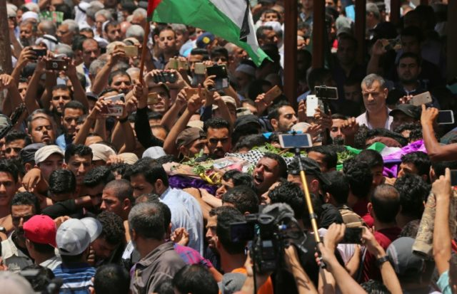 Palestinian mourners carry the body of 21 years old Razan al-Najjar during her funeral after she was shot dead by Israeli soldiers, in Khan Yunis on June 2, 2018