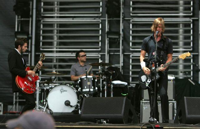Interpol Guitarist Daniel Kessler, Drummer Sam Fogarino and Singer/Guitarist Paul Banks onstage at the Virgin Festival in 2007