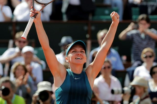 Moment of victory: Simona Halep celebrates after victory over Garbine Muguruza