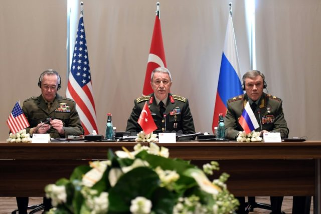 General Joe Dunford (L) and General Valery Gerasimov (R) met in Turkey last year, along with General Staff of the Turkish Armed Forces, Hulusi Akar (C)
