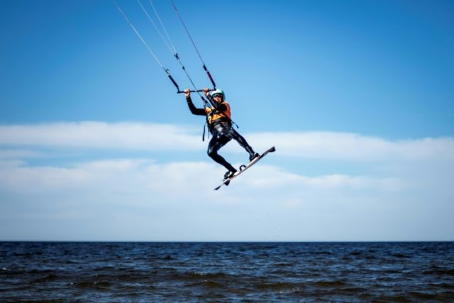 Former Finnish Olympic gymnastics athlete in Rome (1960) and Tokyo (1964), Kauko Heikkinen, 80, rides a kitesurf in Storsand, northern Vaasa, western Finland, on May 26, 2018.