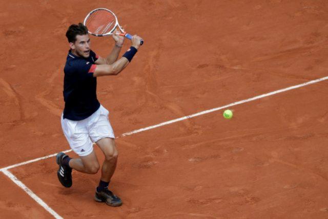 National service: Austria's Dominic Thiem returns the ball to Italy's Marco Cecchinato