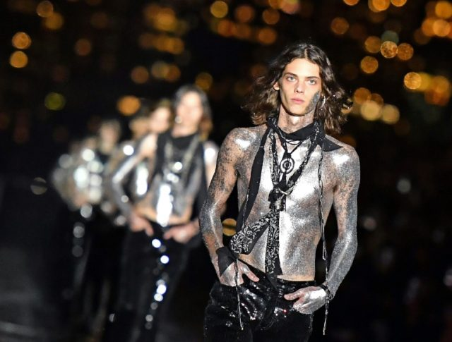 Belgian designer Anthony Vaccarello unveiled his spring-summer 2019 menswear collection for Saint Laurent in New York -- with a trippy Western vibe