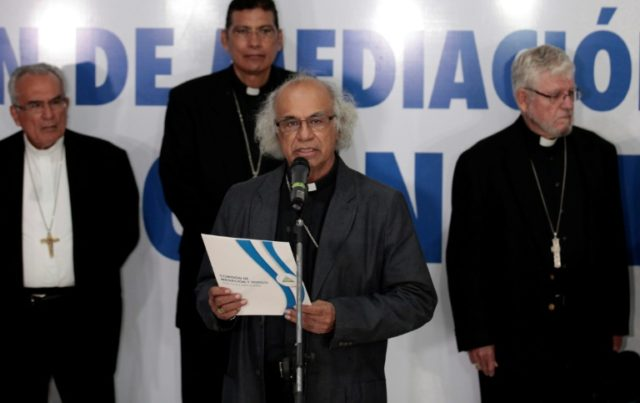 Cardenal Leopoldo Brenes reads a statement after a meeting June 7, 2018 in Managua with Nicaragua's President Daniel Ortega