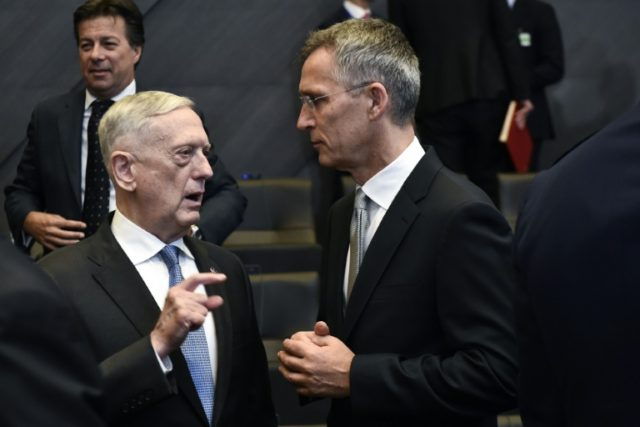 US Defence minister James Mattis (L) talks with NATO Secretary-General Jens Stoltenberg (R) during a meeting at NATO headquarters in Brussels where the Pentagon chief noted efforts by European nations and Canada to boost their defence spending