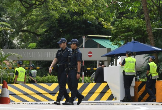 Singapore police patrol at Shangri-La hotel, where Donald Trump is expected to stay. The police deployment for the hotly anticipated meeting is expected to be the biggest since 2006