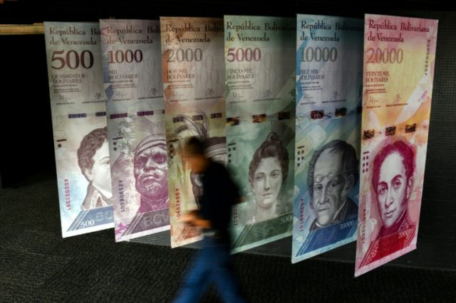 """The various denominations of Venezuela's bolivar are on display at the central bank in Caracas - the country says it is cracking down on currency """"speculators"""""""