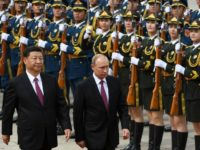 China hosts Russia, Iran for summit as US tensions rise