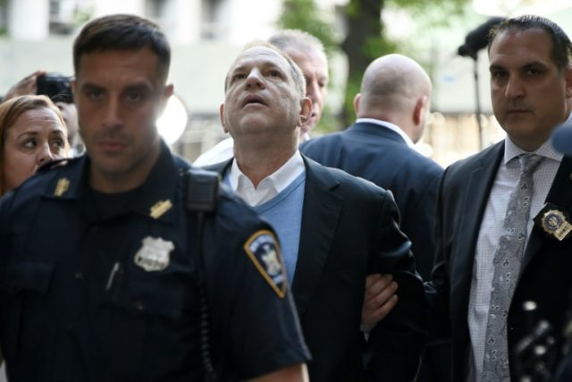 Accusations of decades of sexual abuse by Harvey Weinstein -- pictured (C) arriving for arraignment after being arrested and processed on charges including rape -- were a major catalyst for the #Metoo movement