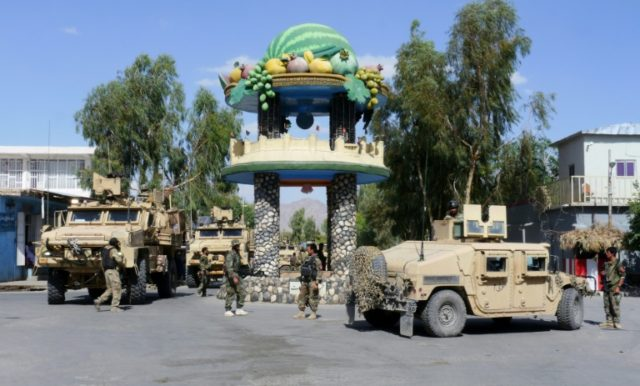 Afghan security forces patrol in Farah after recapturing control of the city from Taliban militants in May