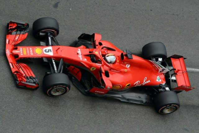 Sebastian Vettel took pole position to end Lewis Hamilton's qualifying supremacy in Canada