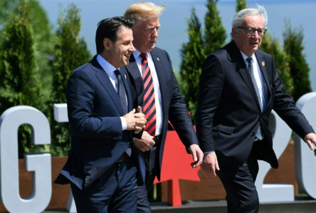 Italian Prime Minister Giuseppe Conte (left) has been in power for only three days but he is already courting support from US President Donald Trump (center)