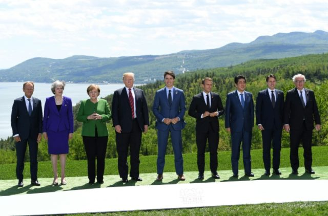 At the G7 summit (L-R): EU president Donald Tusk, Britain's Theresa May, Germany's Angela Merkel, Donald Trump, Justin Trudeau, France's Emmanuel Macron, Japan's Shinzo Abe, Italy's Giuseppe Conte, and European Commission chief Jean-Claude Juncker
