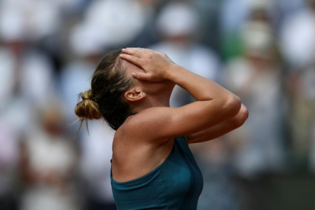 A moment to savour: Simona Halep claimed her first Grand Slam title in her fourth final with a sensational fightback