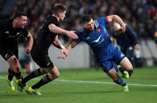 French wing Remy Grosso, seen here earlier in the match against the All Blacks, was rushed to hopsital with a double facial fracture after being smashed in a tackle by All Blacks Sam Cane and Ofa Tu'ungafasi