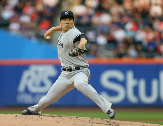 Masahiro Tanaka of the New York Yankees delivers a pitch during the first inning of a game against the New York Mets at Citi Field on June 8, 2018 in the Flushing neighborhood of the Queens borough of New York City