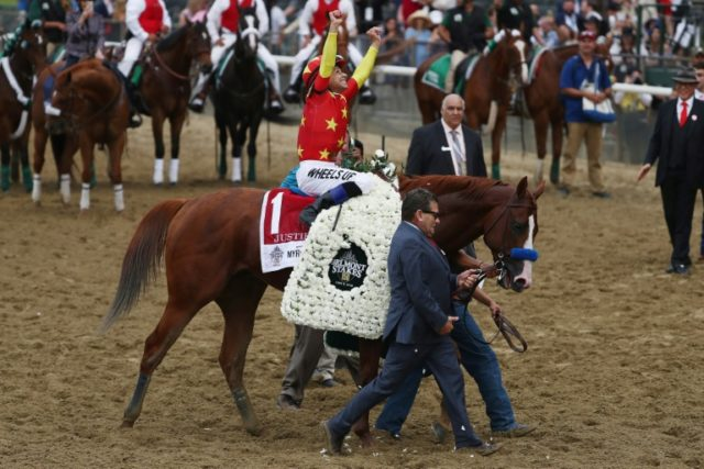 Jockey Mike Smith celebrates atop of Justify at the 150th running of the Belmont Stakes at Belmont Park on June 9, 2018 in Elmont, New York