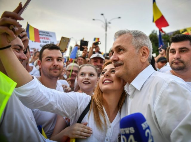PSD leader Liviu Dragnea poses for a selfie with a supporter during Saturday's mass rally against the Romanian judiciary