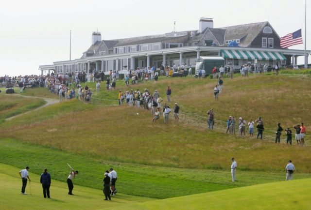 Tiger Woods hits a shot during a practice session at the 104th US Open, at Shinnecock Hills Golf Club in Southampton, New York, in June 2004