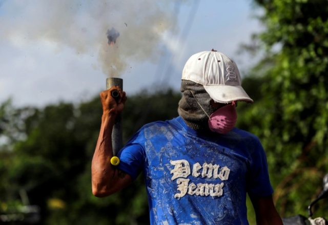An anti-government demonstrator fires a homemade mortar in Masaya, Nicaragua, where demand for the makeshift shells has jumped in recent weeks amid anti-government protests