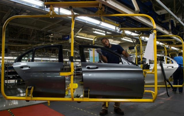 An employee works on the doors for a Mercedes-Benz C-Class, at the Mercedes-Benz US International factory in Vance, Alabama