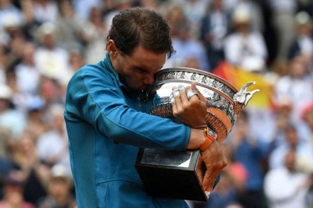 Mine again: Rafael Nadal kisses the Mousquetaires Cup