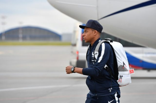 France's national football team forward Kylian Mbappe disembarks from a plane after landing at Moscow Sheremetyevo airport in Khimki