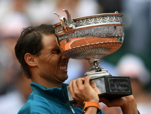 Hello again: Rafael Nadal holds the French Open trophy for the 11th time