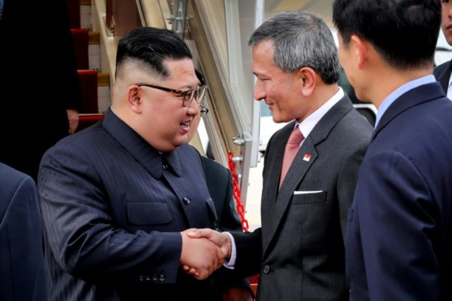 Kim is welcomed by Singapore's Foreign Minister Vivian Balakrishnan (center-R) upon his arrival at Singapore International airport