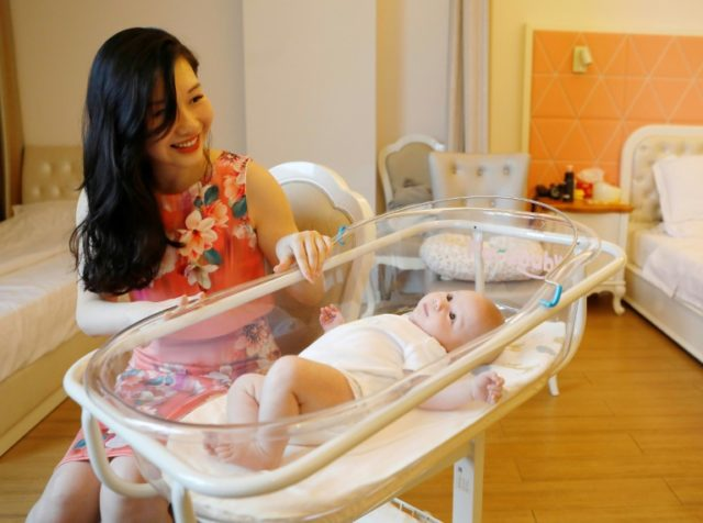 Xu Jingfang sits with her baby at the Lake Malaren International Postpartum Care Center in Shanghai
