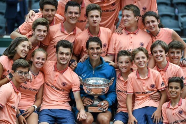 Nadal celebrates with the Roland Garros ball boys and girls after French Open title No. 11