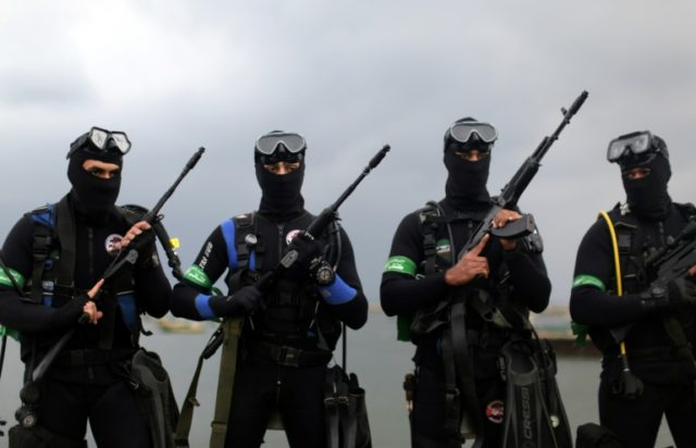Frogmen of Hamas's armed wing take part in a military parade on December 14, 2014 in Gaza City