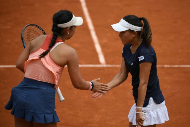 Final chance: Japan's Eri Hozumi and Makoto Ninomiya in action at Roland Garros on Sunday in the women's doubles final