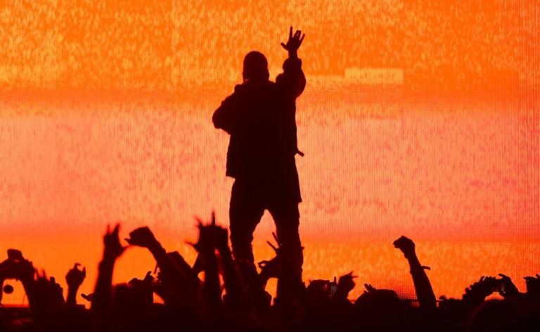 """Ye,"" the new album Rapper Kanye West - here performing at the Bonnaroo festival in 2014 - has debuted at the top of the Billboard 200 chart, marking his eighth straight release to reach number one"