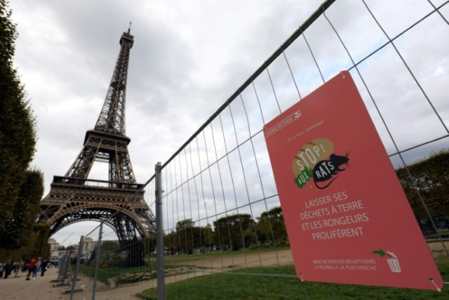 A sign urging people to put their trash in rubbish bins as part of a Paris campaign against rats launched by Mayor Anne Hidalgo last year