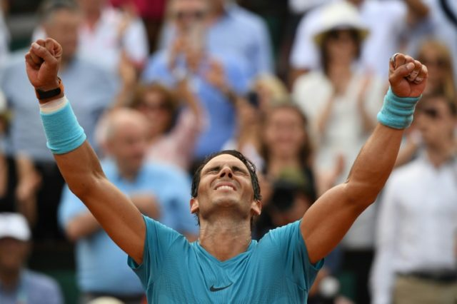 Man of the moment: Rafael Nadal celebrates his 11th title in Paris
