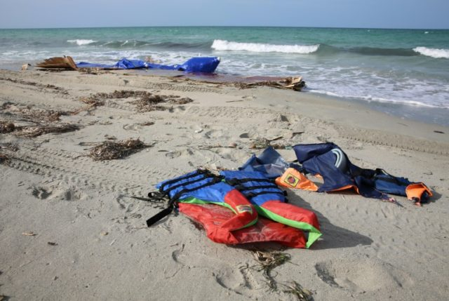 Life jackets on a beach after dozens of migrants drowned in a shipwreck off the coast of Sabrata in September last year