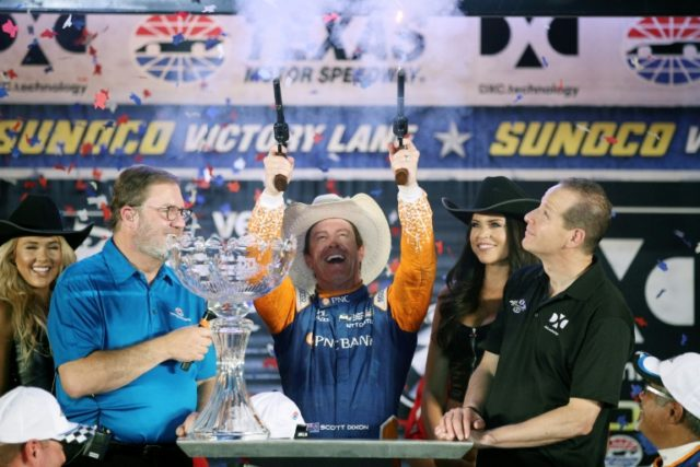 Scott Dixon, driver of the #9 PNC Bank Chip Ganassi Racing Honda, celebrates in Victory Lane by firing guns after winning the Verizon IndyCar Series DXC Technology 600, at Texas Motor Speedway in Fort Worth, on June 9, 2018