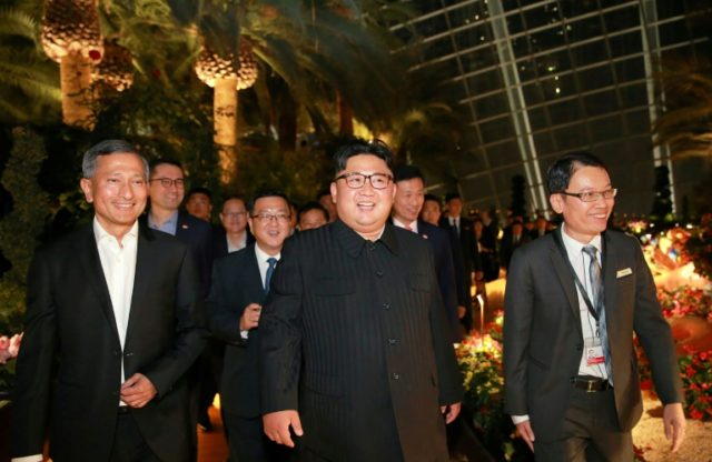 Kim Jong Un was accompanied by Singapore's foreign minister as he went on a waterfront stroll
