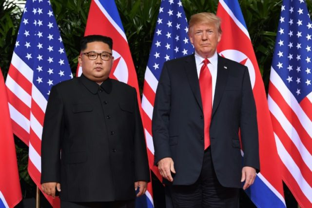 Donald Trump and Kim Jong Un signed a document that spoke of 'new US-DPRK relations' and committed Washington to 'security guarantees'