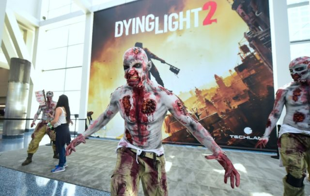 A zombie character sells the game Dying Light 2 at the 24th Electronic Expo, or E3 2018, in Los Angeles